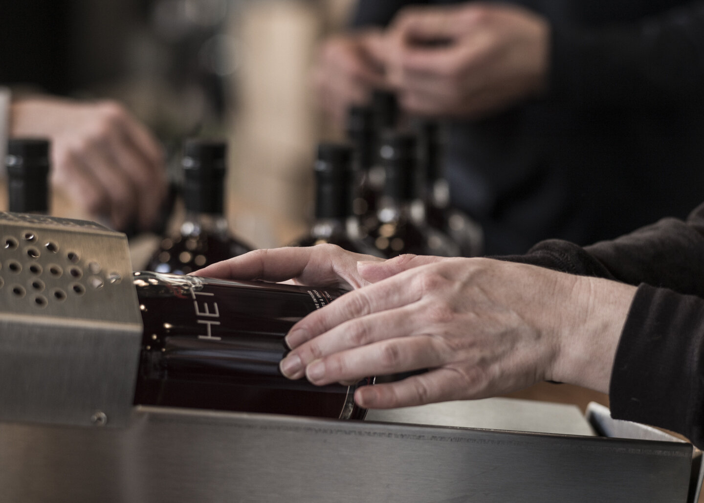 All hands on deck! Bottling day brings three generations together to make our tradition available to others.